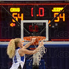 Cutting: Ft. Wayne Canterbury senior guard Matte Troxel cuts down the nets after her team beat Northeast Dubois 64-54 for the class 1A State Championship at Hulman Center Saturday morning.
