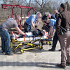 Tribune-Star/Sue Loughlin<br /> Response team: Emergency workers care for ???????? after freeing him from being pinned by a burial vault in Bethesda Cemetery.