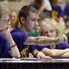 Tribune-Star/Jim Avelis<br /> Right here: Otter Creek Middle School students Zach Burchyett, Harry Chambers and Yonah Wasik look over a question in Wednesday night's Geography Bowl at Sarah Scott Middle School. The north side team led a good part of the night.