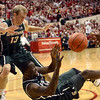 Tribune-Star/Joseph C. Garza<br /> Take this: Michigan State's Austin Thornton blocks out Indiana's Will Sheehey as teammate Draymond Green passes the ball during the Hoosiers' win Feb. 28 in Bloomington.
