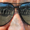 Tribune-Star/Jim Avelis<br /> Girls of Spring: Members of the West Vigo softball team are reflected in Athletic Director Mike Miller's sunglasses just before the start of their game with Turkey Run.