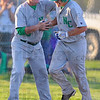 Tribune-Star/Jim Avelis<br /> Atta boy: North Central coach Craig Grow congratulates Nate Lyday on his two run home run that put the Thunderbirds up 7-2 over visiting West Vigo.