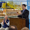 ribune-Star/Joseph C. Garza<br /> Growing: Bryan Q. Eshelman, Charming Shoppes' executive vice president and chief supply chain officer, applauds with Greencastle Mayor Sue Murray and Gov. Mitch Daniels after he announced a plan to expand the plant during a press conference Wednesday in Greencastle.