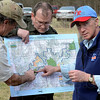 Tribune-Star/Joseph C. Garza<br /> Where we are: Mark Reiter and Tom Swinford, both with the Indiana Department of Natural Resources, help Gov. Mitch Daniels find their location on a map of the Healthy Rivers Initiative Wednesday near the Sugar Creek corridor in Parke County.