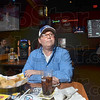 Tribune-Star/Joseph C. Garza<br /> End of an era: Indianapolis Colts fan Gary Maners watches Jim Irsay's and Peyton Manning's televised press conference Wednesday at Buffalo Wild Wings.