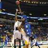 Driving right at 'em: Indiana State's Myles Walker drives to the basket over Wichita State's Toure' Murry and Carl Hall during the Sycamores' 72-48 loss Friday in the Missouri Valley Conference Tournament in St. Louis.