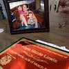 Heroic: A plaque and photograph of Kayla Lewis and her two children sits on the break table at Fire Station #5 Monday evening to remember the one year anniversary of the fatal fire.
