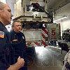 Fire anniversary: Rich Gallagher and Ron Terrell explain the Protect the Precious smoke detector program Monday evening to Kayla Lewis' mother at fire station #5 on the one year anniversary of the fatal fire.