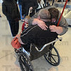 Tribune-Star/Jim Avelis<br /> Together again: Cathy Bush hugs her father Darold Murray for the first time in 24 years. A Champaign Ill. radio station made the reunion possible. Bush brought her husband James and children Rachel and J.J. to the Indianapolis airport for the event.
