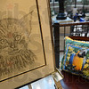 Tribune-Star/Jim Avelis<br /> Exceptional art: A pencil sketch and a pillow with a macaw print were two of the pieces of art at the Celebrating Exceptionalities in the Arts on display Monday evening in University Hall.
