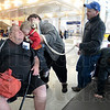 Tribune-Star/Jim Avelis<br /> Kisses: Darold Murray gets a kiss from his grandson J.J. Bush in the Indianapolis airport. Watching the event are J.J.s dad James amd sister Rachel. Mom Cathy holds her son.