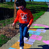Tribune-Star/Joseph C. Garza<br /> Hop, skip and learn: Six-year-old Jiayun Ji hops on one of the activities on the Born Learning Trail Tuesday at Fairbanks Park. Steve Weatherford's Rush the Punter event will help raise funds for the trail.