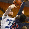 Tribune-Star/Jim Avelis<br /> Inside two: Justin Gant scores two for Indiana State. He shoots over the defense of Robert Morris' Lucky Jones.