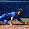 Tribune-Star/Joseph C. Garza<br /> One and done: Indiana State's Danielle Ketner scores the Sycamores' one and only run in the first game of the Sycamores' double-header against St. Louis Tuesday at Price Field. Ketner's run won the game for the Sycamores.