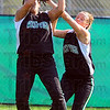 Tribune-Star/Jim Avelis<br /> Near miss: Wet Vigo left fielder Leslee Walters and center fielder Kenzie Little collide reaching for a fly ball early in the Vikings game with visiting Marshall.
