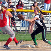 Tribune-Star/Jim Avelis<br /> Run down: West Vigo shortstop Cassidy Carlson applies the tag to Marshall baserunner Carson Boyer after Boyer was caught off third base.
