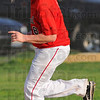 Tribune-Star/Jim Avelis<br /> Help yourself: Marshall pitcher K.J. Rogers allows himself a smile as he nears third base on his home run trot. The two-run homerun to right field gave the Lions a 4-0 lead over visiting Paris.
