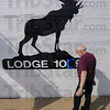 Tribune-Star/Jim Avelis<br /> Sprucing up the moose: Ed Akers looks over his paint job on the front of the Moose lodge on east Wabash Tuesday afternoon. The lodge, home to about 500 members, is celebrating its 100 anniversary.