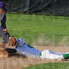 Tribune-Star/Jim Avelis<br /> Too fast: West Vigo baserunner Kyle Stewart gets a stolen base, arriving in a cloud of dust ahead of the tag by Greencastle shortstop Ryan Pettit.