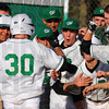 Tribune-Star/Jim Avelis<br /> Welcome home: Cody Thornton(30) is welcomed at home plate after a towering homerun against Greencastle Tuesday evening on the Viking's diamond.