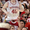 Tribune-Star/Joseph C. Garza<br /> Fan favorite: An Indiana fan holds up a cardboard cutout of the Hoosiers' Cody Zeller during the team's game against Northwestern Feb. 15 in Bloomington.