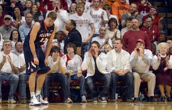 He felt that one: Indiana fans let their opinions be known as Illinois' Meyers Leonard feels the aftereffects of guarding Indiana's Cody Zeller after Zeller drove to the basket against Leonard during the Illini's visit to Bloomington Feb. 9.
