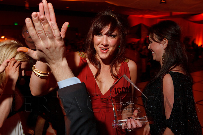 """Gabby Cavali of Save the Date Events, gets a high-five for the """"Best Wedding under $75,000"""" category.  The ICON Awards Gala 2012, presented by Colorado Expression and Confetti magazines, at Grand Hyatt Denver near Denver, Colorado, on Friday, March 9, 2012.<br /> Photo Steve Peterson"""
