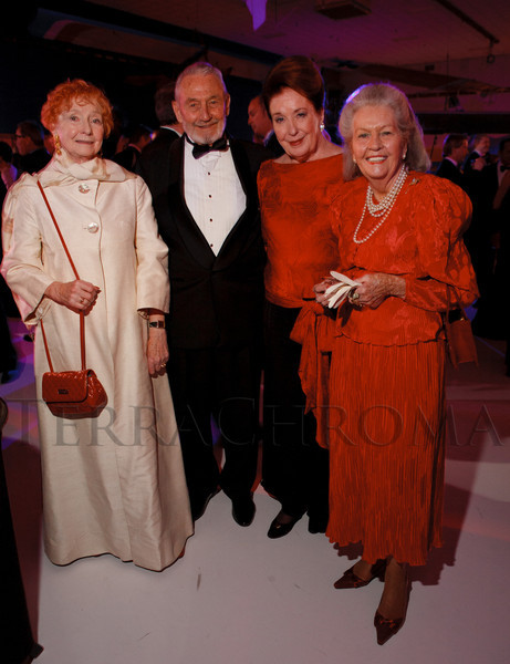 Jane Earle, Ken Bradford (WWII and Korea veteran with the Marines), Mary Rae, and Patterson Benero (wearing Mary McFadden).  The Beaux Arts Ball, benefiting National Jewish Health, at Wings Over the Rockies Air & Space Museum in Denver, Colorado, on Saturday, March 10, 2012.<br /> Photo Steve Peterson