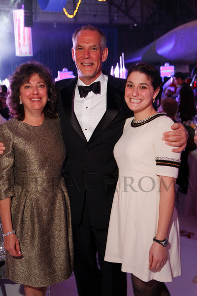 Margie and Tom Gart with daughter, Caroline.  The Beaux Arts Ball, benefiting National Jewish Health, at Wings Over the Rockies Air & Space Museum in Denver, Colorado, on Saturday, March 10, 2012.<br /> Photo Steve Peterson