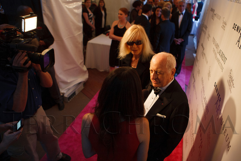 Pierre Berg and Betty Catroux speak with E! News.<br /> Photo Steve Peterson