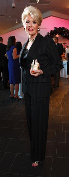 "Diane Huttner in a vintage YSL tuxedo, ""Le Cigarette,"" holding a Judith Leiber penguin minaudiere.<br /> Photo Steve Peterson"
