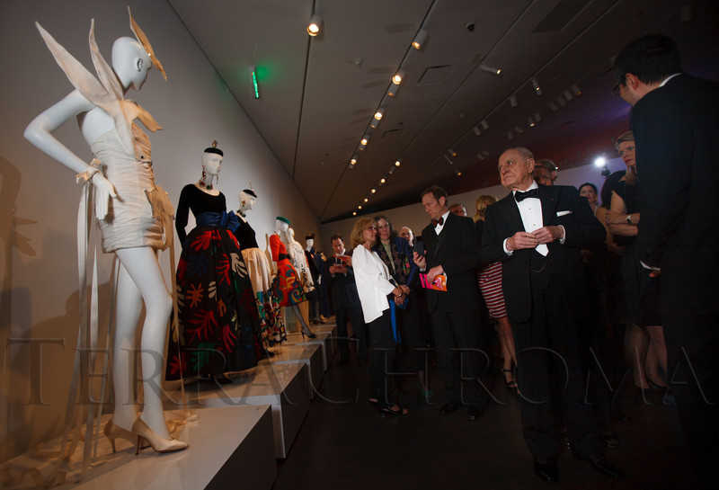 Pierre Bergé, right, walks through the YSL exhibit with friends and dignitaries.<br /> Photo Steve Peterson