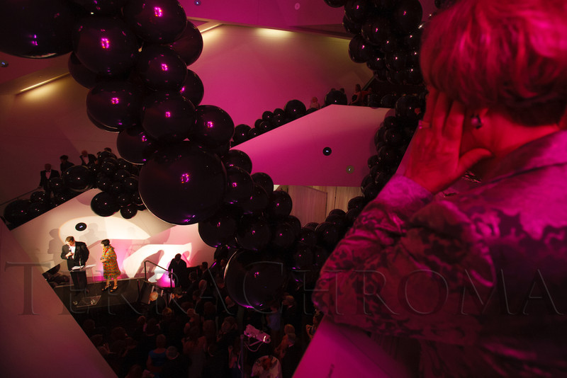 Large black balloons were strung throughout, seen here while Christoph Heinrich and Florence Müller make remarks.<br /> Photo Steve Peterson