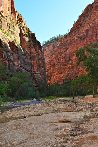 hiking through a large slot canyon