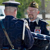 Tribune-Star/Joseph C. Garza<br /> New stars and stripes: Andy Whitt, III, of the VFW Post 972 Color Guard presents a flag to Terre Haute Assistant Police Chief Shawn Keen during the police department's memorial ceremony Thursday at the police headquarters.