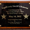 Tribune-Star/Joseph C. Garza<br /> Commissioned this day: The plaque that is attached to the wall under the new Vigo County Sheriff's Department Memorial.