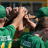 Tribune-Star/Joseph C. Garza<br /> Like family: The North Central baseball team comes together before the start of the team's game against Sullivan Tuesday at North Central.