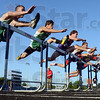They're off: Runners clear the first hurdle during the high hurdle final at the Sectional Track Meet Thursday afternoon.