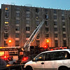 Fire: A ladder truck reaches to the sixth floor of Garfield Gardens Thursday evening as approximately 240 residents were evacuated because of a fire.