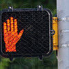LED stop: Detail photo of newly installed walk-don't walk LED crosswalk lights.
