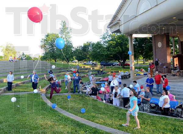 Tribune-Star/Jim Avelis<br /> A wing and a prayer: Balloons, with a card carrying a written prayer tied on, lift off from the Fairbanks Park amphitheater at the end of the National Day of Prayer observance Thursday evening.