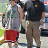 Tribune-Star/Jim Avelis<br /> In custody: 18-year-old Brandon Bennett walks handcuffed to the Vigo County jail Thursday afternoon. With him are Chief deputy Clark Cottom, in back, and 1st Sgt. Charley Funk.