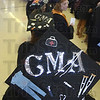 Tribune-Star/Jim Avelis<br /> Graduation day: Ivy Tech Community College Wabash Valley graduate Tomeeka Gross decorated her mortarboard with symbols of her new profession, Medical Assistant.