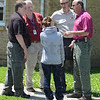 Tribune-Star/Jim Avelis<br /> Good hands: Alyssa Sedletzeck, center, talks with sheriff's deputies after she had been found in a house in the 2900 block of Fenwood Avenue in Terre Haute Thursday.