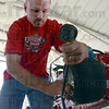Pressure: Greg Dillion checks the tire pressure in one of his son's quarter midget race cars Friday afternoon.