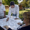 Meeting: Area residents Rick Wheeler, Mike Poinsett and Kathrynn Myers look at drawings for the Cobblestone Crossing project Friday afternoon.