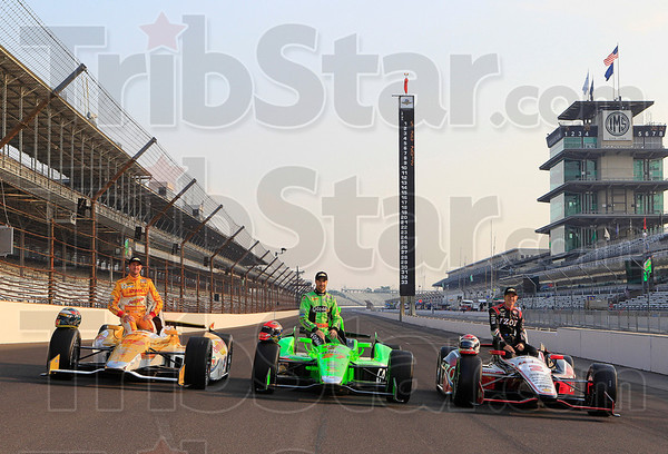 During the Sunday, May 20 front row photo shoot, Ryan Hunter-Reay, left, James Hinchcliffe, center, and Ryan Briscoe, right,  pose with their cars for photographers  after qualifying at the Indianapolis Motor Speedway in Indianapolis, on Saturday May 19, 2012.  (AP Photo/LAT, Phillip G. Abbott)  MANDATORY CREDIT