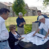 Plans: Area residents Mike Poinsett, Kathrynn and Michael D. Myers and Rick Wheeler show Tribune-Star reporter original plans for the Cobblestone project during a meeting Friday afternoon.