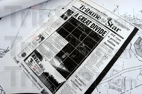 Paper: Detail photo of an old Tribune-Star announcing the Cobblestone Crossing project.