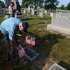 Tribune-Star/Joseph C. Garza<br /> Found it: American Legion Post 139 member Ron Moreland plants a grave marker flag into the ground near the  grave of a veteran Saturday at Center Ridge Cemetery in Sullivan. Moreland and fellow post members Jerry Smith and John Parris were working together to plant a flag into every veteran's grave in an assigned section of the cemetery.